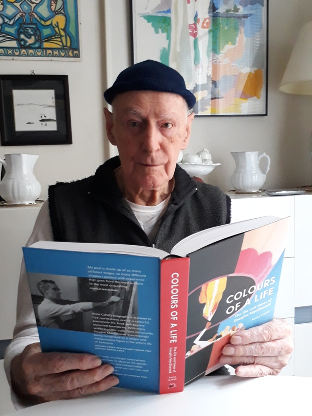 Douglas MacDiarmid proudly holding his life in his hands at the age of 95. His only complaint is the weight of the book making it impossible to read in bed. Taken October 2018.